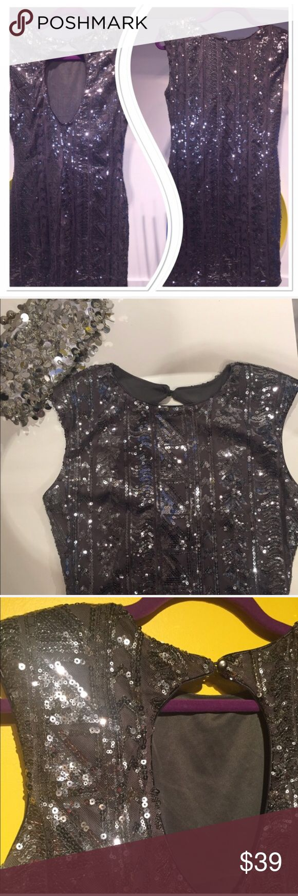 "Boutique New Years Sequined silver bodycon dress Sexy Sequined silver bodycon short dress. Comes from New York boutique silver - gray sequins, sexy opening on the back, dress is fully lined. Size Small. Length - 32,5"" pit to pit 16"". Light padding on the shoulders to keep the shape. Beautiful material, has some stretch to it, but hugs your body and compliments all the curvesCondition- very good, worn once. Celebrate your special occasion -in this dress and you are going to sparkle…"