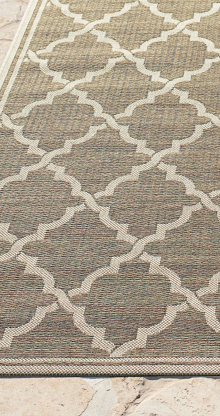 Easy decorating class: try a multipurpose Hyannis Outdoor Rug for your patio, deck, or sunroom.