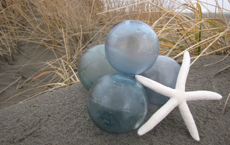 """This semi-frosted, 3.5"""" diameter glass float was beach combed intact from along a remote Pacific Northwest shore. It is a soft tealish blue color. It will come gift boxed with a card that tells the following history:"""