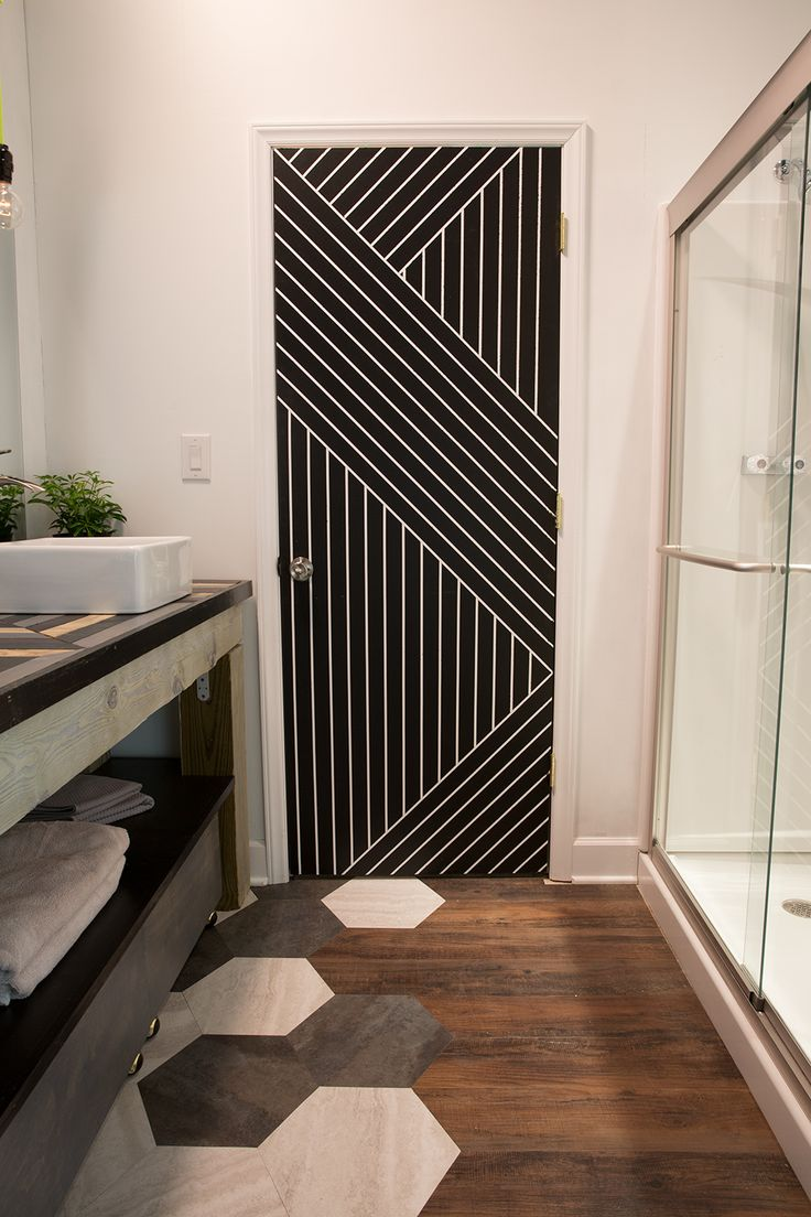 Plain door painted with an awesome design using just paint and painters tape...