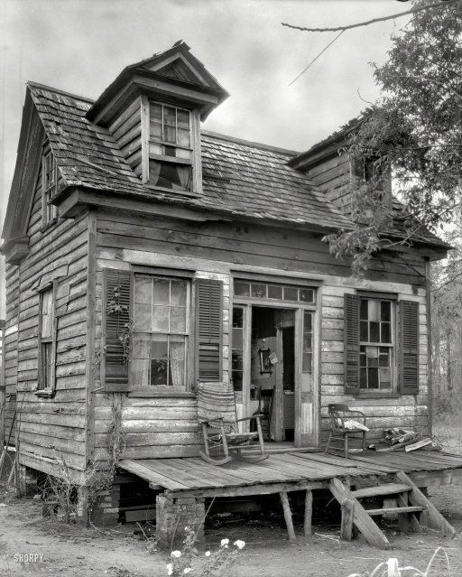 "Circa 1936 Georgetown County, South Carolina."" Security system visible in dormer. From comments: "" the enormous poverty found throughout the south that resulted from the Civil War and finally came to an end in the late 60's has never really been documented or experienced by states above the Mason Dixon line. The south generally suffered 100 years of poverty as a result of the war."""