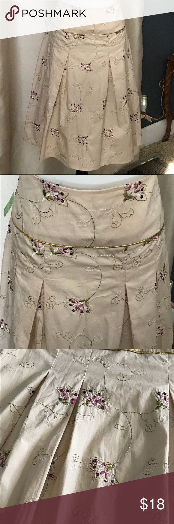 A line pleated skirt. Sequin and embroidery Cutest A Line pleated skirt with delicate embroidery and small sequin in the flower to add sparkle. Waist band has a gold detailing. Never been worn. New with tags. Skirts A-Line or Full