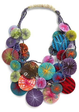 """Thread. """"Diameters Are a Girl's Best Friend"""" by Karma Living on Modcloth.  Thread, discs, fabric."""