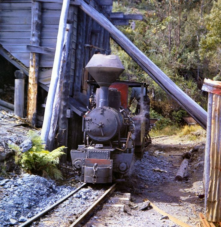 Wee Georgie Wood standing at the North Mount Farrell Mine loading bins,  Tasmania. This photo was taken in 1964, by which time operations were restricted to a half-mile of track between the mine and the flotation plant. Photo: late Jim Baines, courtesy Association of Railway Enthusiasts.