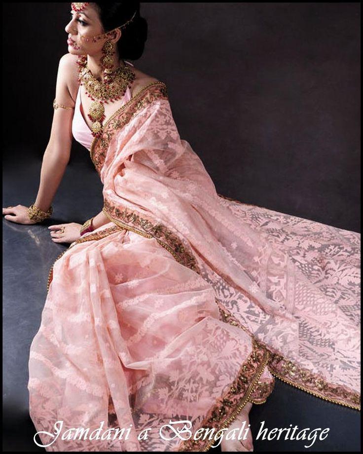 Lovely pink Dhakai Jamdani Saree with zari border.