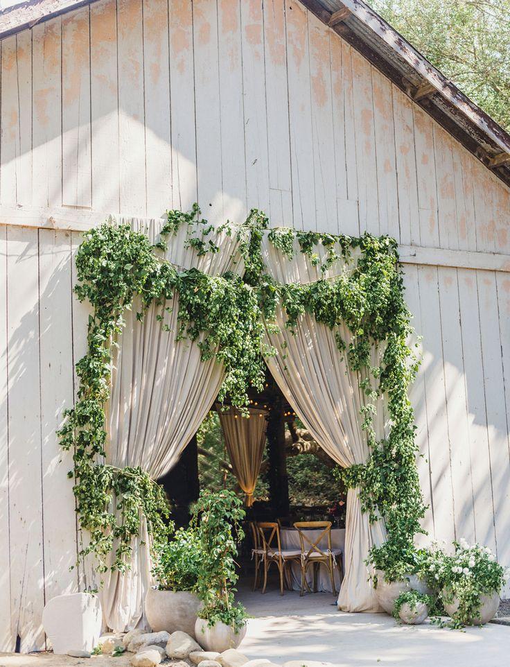 garland barn door // Dos Pueblos Ranch in Santa Barbara wedding // beach and barn wedding in california with twinkling lights