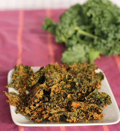 Cheesy Kale Chips:   3/4 cup cashews  1 bunch kale, washed and dried  1/2 red bell pepper, stem and seeds removed, chopped into large pieces  1 clove garlic, peeled  1 tablespoon soy sauce  2 tablespoons vegetable oil  1/3 cup nutritional yeast (not to be confused with Brewer's yeast)  1 lemon, peeled, cut into wedges, and de-seeded as much as possible