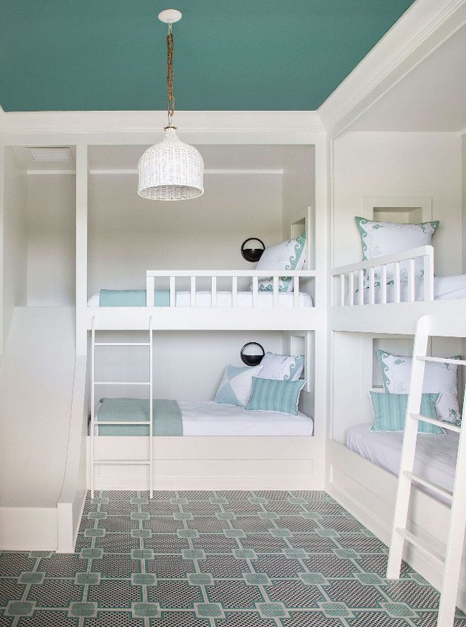 This bunk room makes you wish you were still a kid! It features four bunk beds and a custom slide. The floor is engineered wood tile from Mirth Studio.
