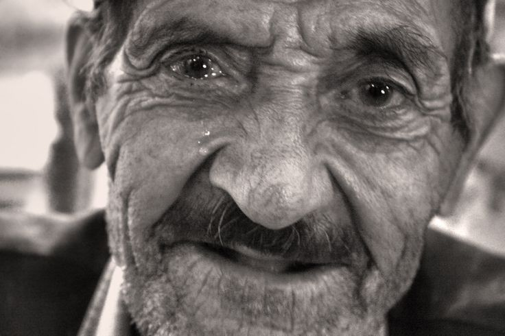 Tabriz , Iran  Tears and smiles   Feels like he doesn't want anyone knows about his sadness and sorrows and tiresome ,  but my camera got really close to him in a way that i have both his tears and his smile in my shot ...  Photo by seyed ali sajadi