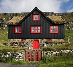 Orange and Black, The Faroe Islands  Under Danish laws, for large justice problems, the (mainly Norwegian) people are around 50, 000 and they govern themselves. They're not part of the European Union. Smartpeople!   They like the Swiss, have their barns underneath their homes, keeping the animals from freezing. This is a more modern one.