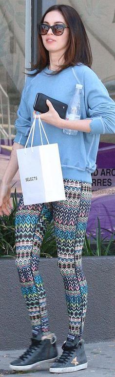 Who made Megan Fox's blue print sneakers, print leggings, and black sunglasses?