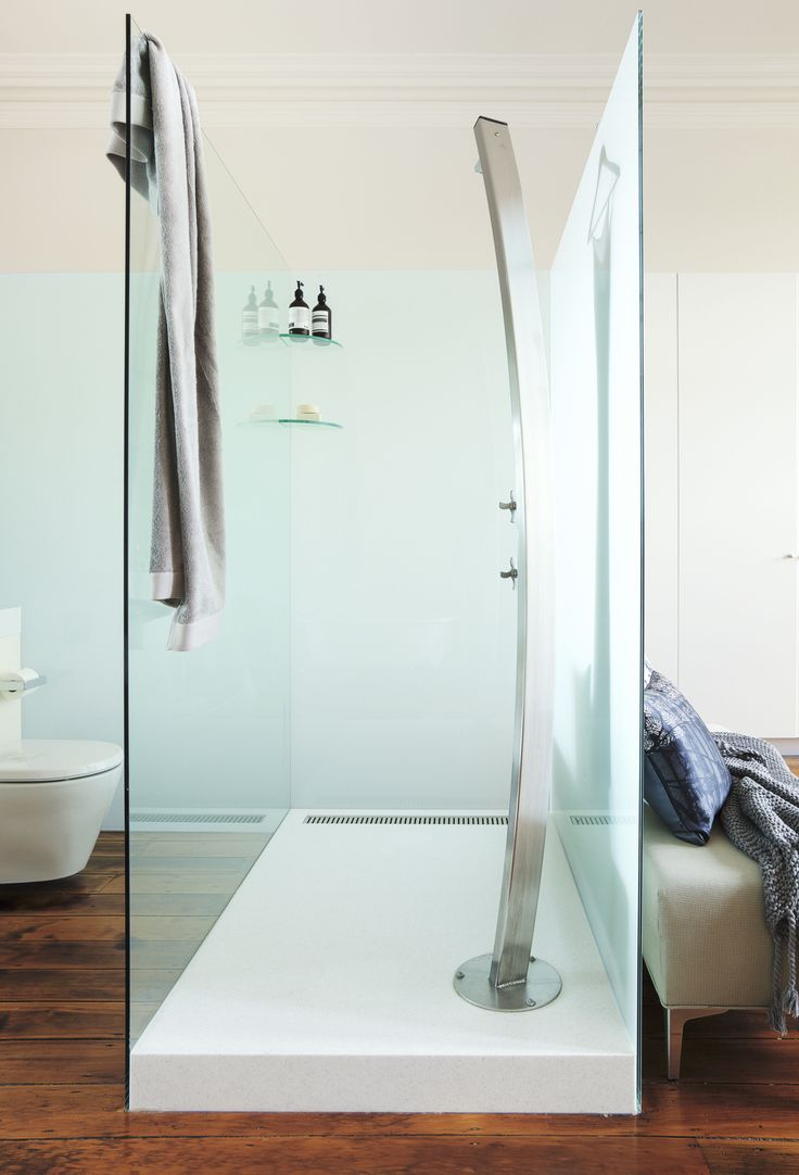 The custom-made shower cubicle is made from toughened glass on a Corian base.