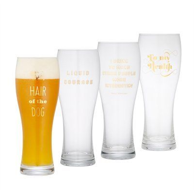 """Spread some good cheer with our new beer glasses, each printed with one of four gilded toasts: """"Liquid Courage,"""" """"Hair of the Dog,"""" """"To My Health,"""" or """"I Drink to Make Other People More Interesting."""""""