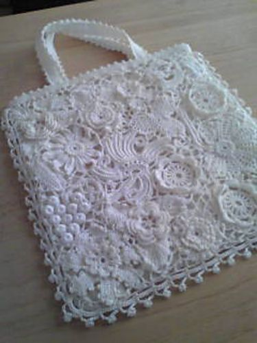 Ravelry: #20 Irish Crochet Lace Bag pattern by Kazekobo ... this would be a cool throw.