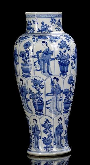 A good blue and white porcelain vase with beauties and boys near flower pots, China, leaf mark, Kangxi period.