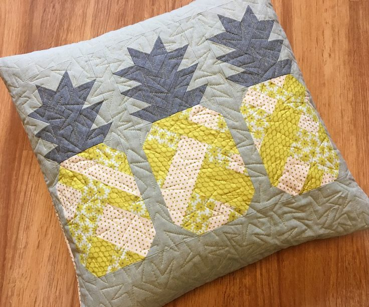 """Quilt and Pillow Pattern by Elizabeth Hartman Use your favorite fat quarters or 10"""" fabric squares to piece these sweet patchwork pineapples! Pattern includes instructions for 3 quilt sizes and a 20"""""""