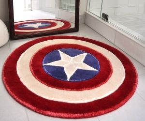 A plush wool and bamboo hand-tufted rug in the shape of Captain America's shield. It's life-size, coming in at 3 feet by 3 feet. Perfect for a sitting room, bedroom, bathroom, or superhero lair.