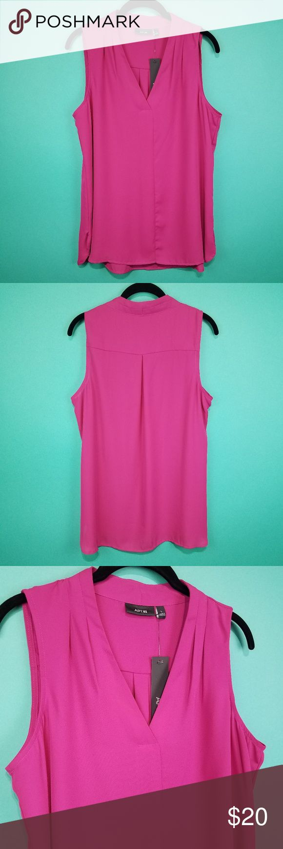 """Apt 9 Fuchsia Sleeveless Blouse Apt 9 Pink Sleeveless Blouse Features: Bright fuchsia flowy lightweight fabric V-neckline style with seam down front Seam across upper back and slight gathering detail  Size: L Measurements are taken across the front with garment laying flat Armpit to armpit: 20 1/2"""" Length: 26-28"""" Measurements are approximate   New with tag Original tag price: $30 As seen in pictures Colors may vary depending on your monitor/screen  CC2 Apt. 9 Tops Blouses"""