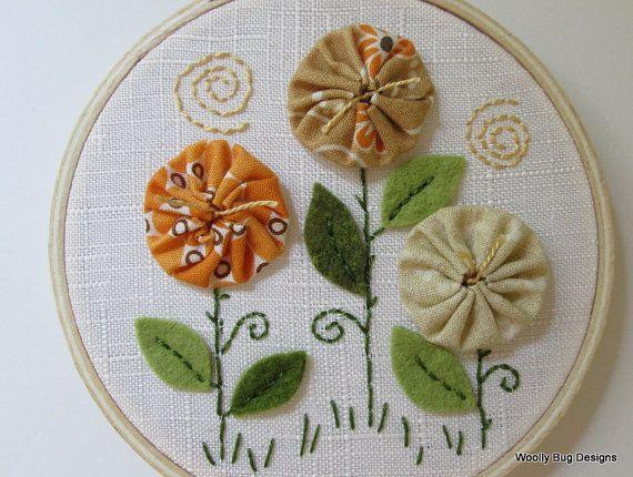 Yo Yo Flowers with wool felt leaves.  By WoollyBugDesigns, $22.00