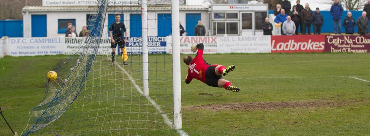 Stranraer's keeper Cameron Belford can't stop Ross Millen's penalty during the Ladbrokes League One game between Stranraer and Queen's Park.