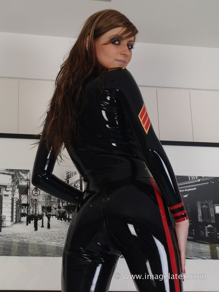 ImageLatex.com: Anastacia wears a latex military catsuit ...