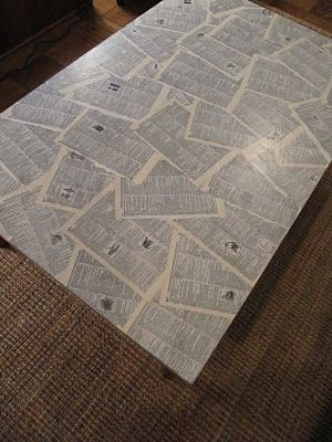 I like this idea for coasters (Original message: Mod Podge'd coffee table covered with dictionary pages. This would be much cooler with pages from one of my favorite novels, like The Lord of the Rings, for instance. But I do love dictionaries.)