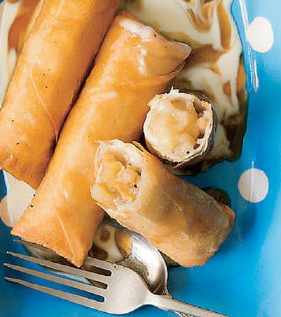 Banana spring rolls with butterscotch sauce.  Reminiscent of the Malaysian street snack, pisang goreng, it's a combination of sweetness and crunch. From the book, Same Same but Different (HarperCollins)