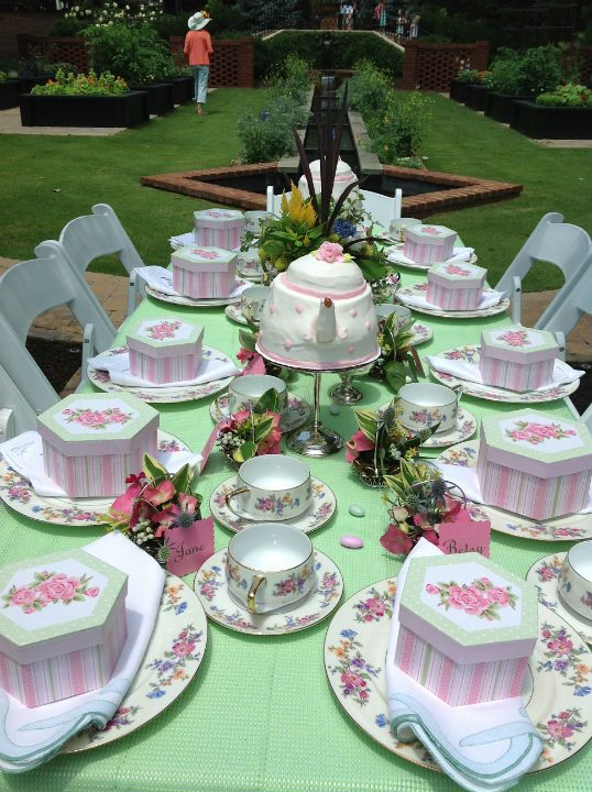 I love the boxes at each place setting. They have gloves and a pearl necklace inside, what a great idea!  The teapot cake is cute too!