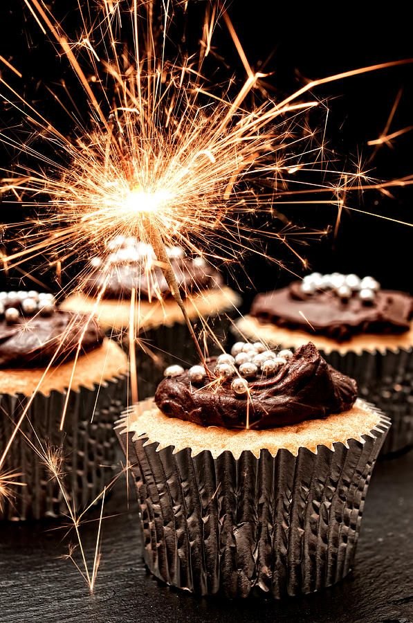 Cupcakes decorated with chocolate ganache with sparklers