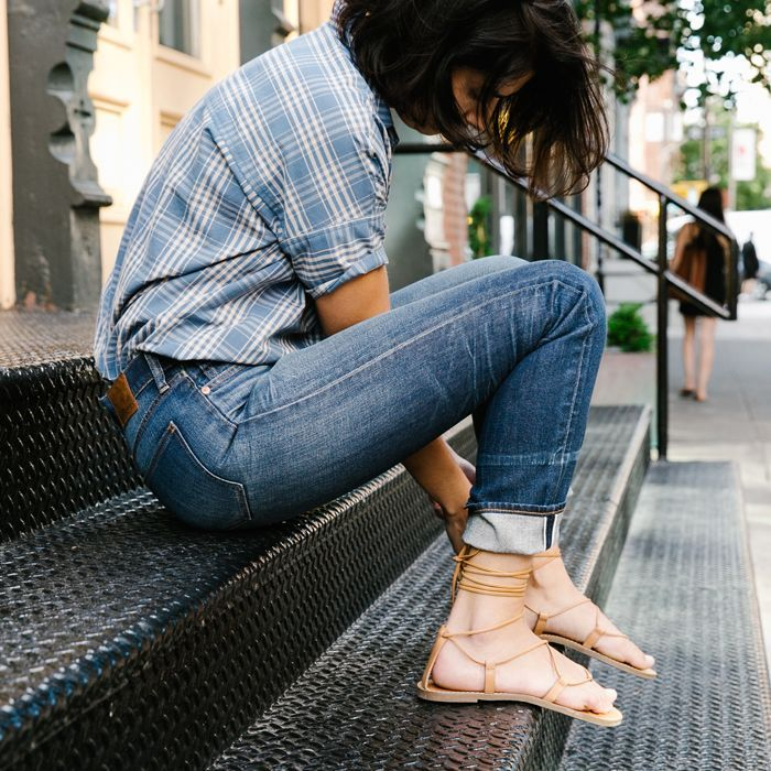 casual plaid shirt with rolled denim and sandals