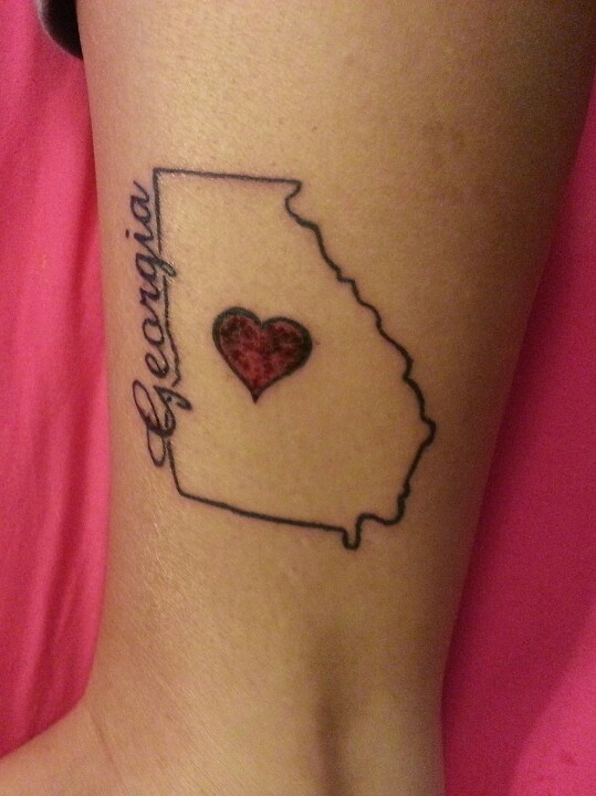 My first tattoo, a day after it was done. I absolutely love!!!!!!!!!! Georgia tattoo(: red heart (: outline(: