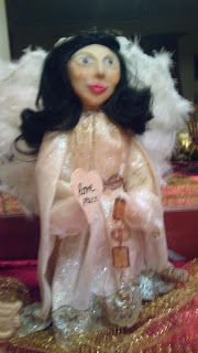 an angel ....a altered bottle of cola...the face is made out of handmade clay...