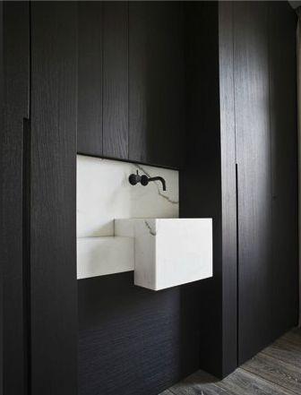 White marble and black wood by Steven van Dooren.
