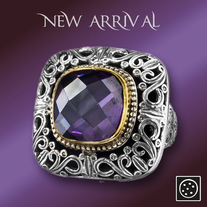 A new large sterling silver cocktail ring with gold accents and zircon gemstone