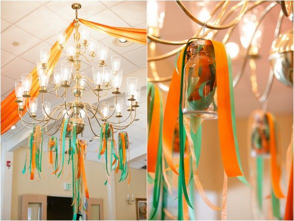 Green and Orange Wedding Ribbons Pouring Out Of Mason Jars