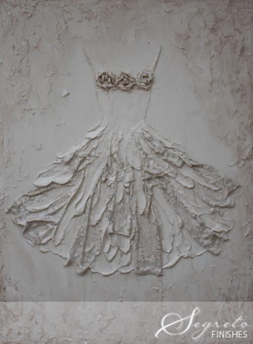 Rachel has created a signature style with these plaster masterpieces. She has done so many personilzed commissions of wedding and christening gowns. What wonderful heirlooms these become.  This plaster work on wood is embedded with lace - so creative and romantic!!