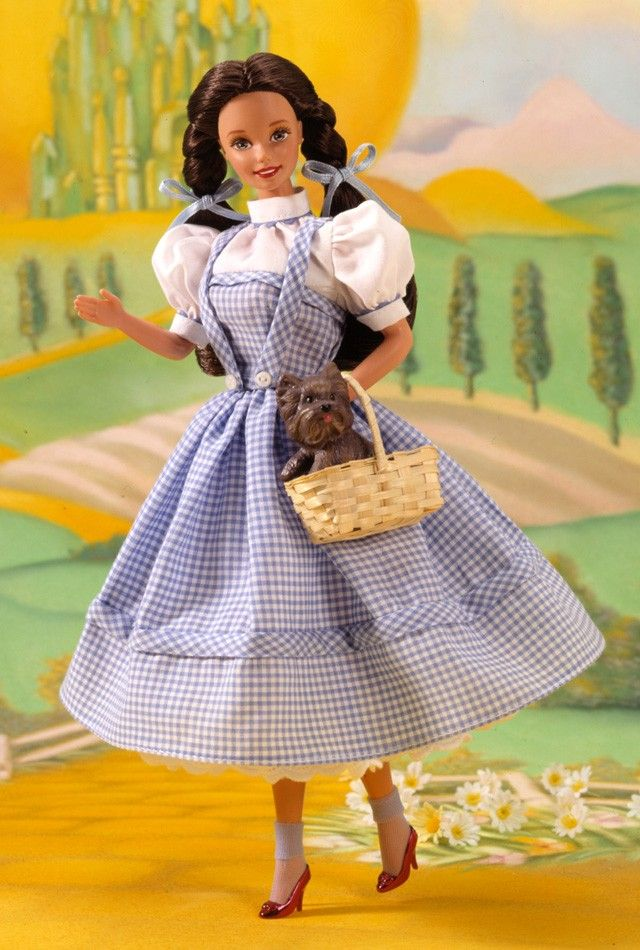 "Collector Edition  Release Date: 1/1/1995  Product Code: 12701    Barbie® as Dorothy is off to see the wizard! And she's wearing an authentic replica of the dress Dorothy wore in the movie. From her crisp blue gingham jumper and white petticoat all the way down to her magical ""ruby"" slippers, this Collector Edition doll is sure to make you smile."