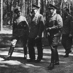 Adolf Hitler with Colonel Friedrich-Wilhelm Müller and other officers at one of Hitler's field headquarters, 25 Jul 1942