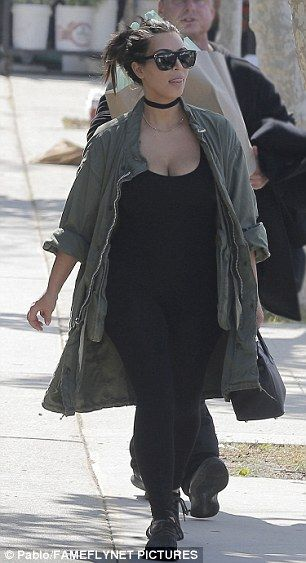 Kim, 35, showed off her newly slimmed down figure in a low cut top and black skintight leggings