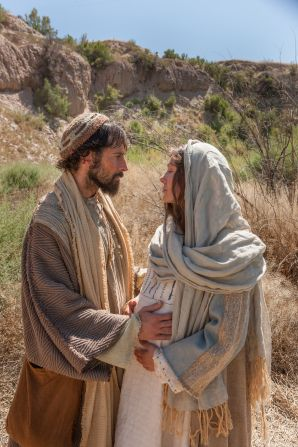 Mary and Joseph stop to rest on their journey to Bethlehem.