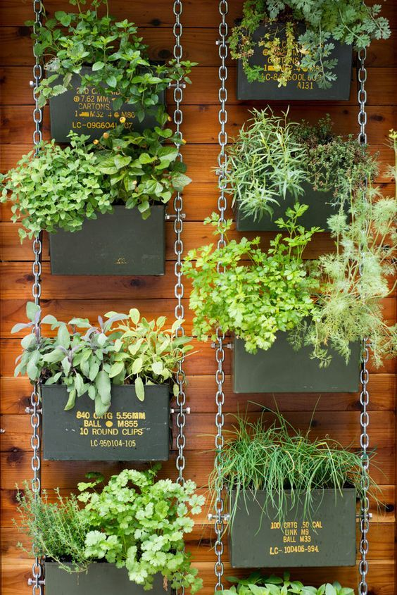 Make a similar hanging garden with ammo cans. | 31 Clever Ways To Decorate Your Outdoor Space