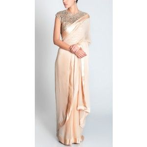champagne georgette sari worn with sequinned torquoise and gold embroidered boned corset.