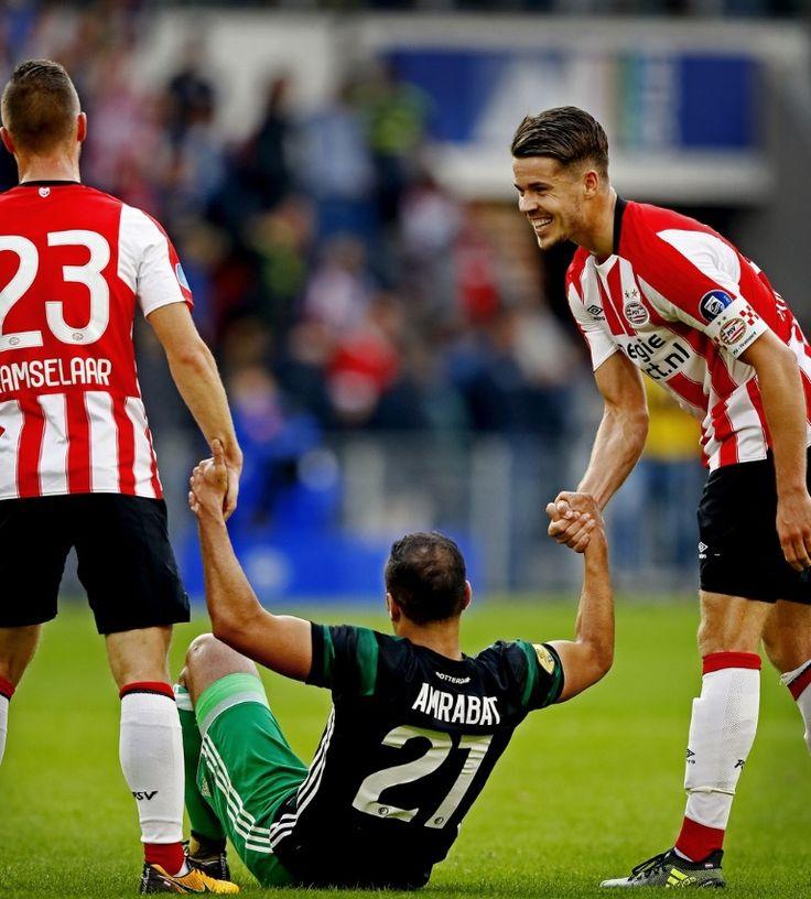 Bart Ramselaar en Marco van Ginkel helpen Feyenoorder Sofyan Amrabat overeind.