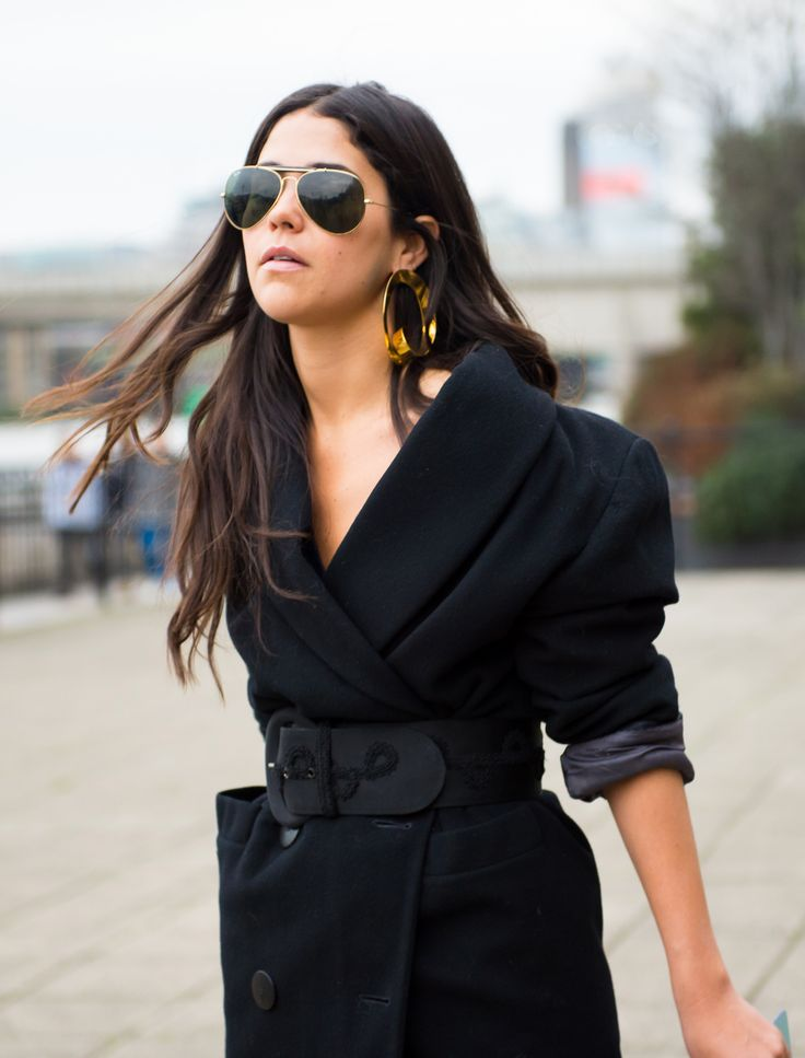 Oversized earrings are the trend of the season, shop now at Farfetch