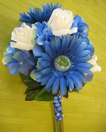 Blue wedding flowers for May | orange, blue, and white so I may go with orange here instead of blue ...