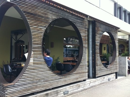 St Kilda Pelican Restaurant, wooden slatting facade with circle cut out