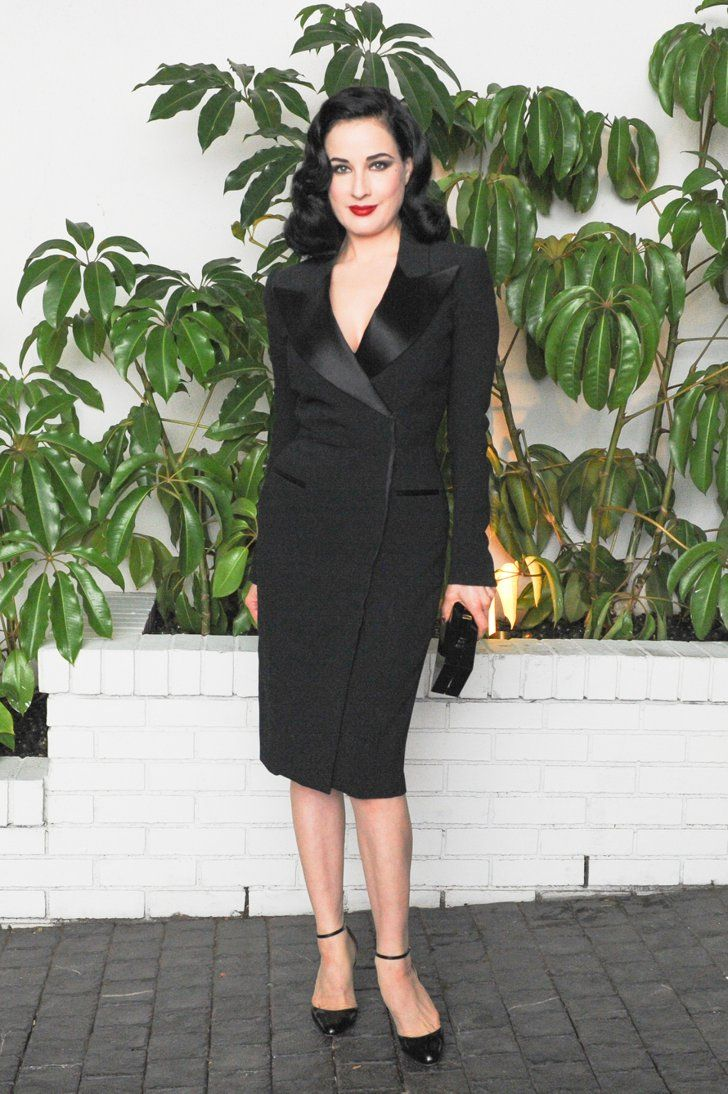 Pin for Later: W Mag Kicks Off the Golden Globes Parties With a Very Stylish Soiree Dita Von Teese We had to include Dita Von Teese in this Le Smoking tuxedo dress because she's just that: le smoking.