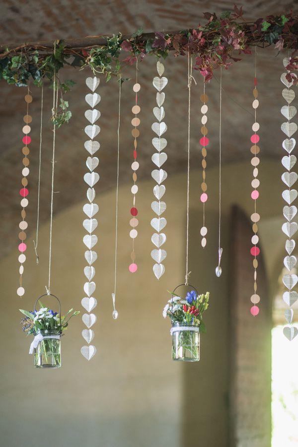 hanging paper garlands - easy DIY! photo by Giuli&Giordi http://ruffledblog.com/san-sebastiano-da-po-destination-wedding #diygarland #weddingdiy #weddingideas