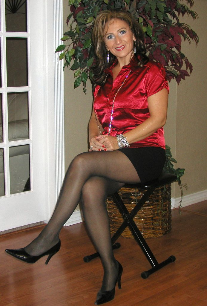 pics of woman in lingerie over 40 woman sitting in chair wearing black pantyhose 1215