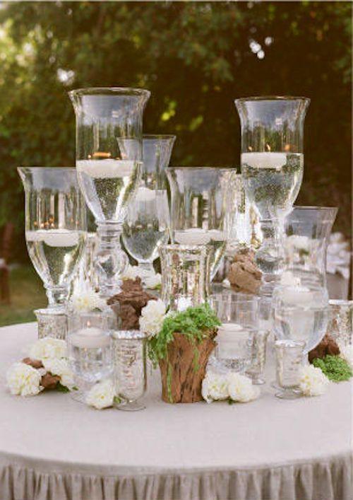 centerpiece using tiers of vases